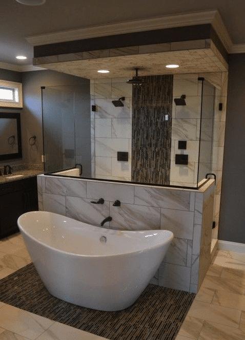 salle de bain avec double douche à l'italienne et baignoire îlot